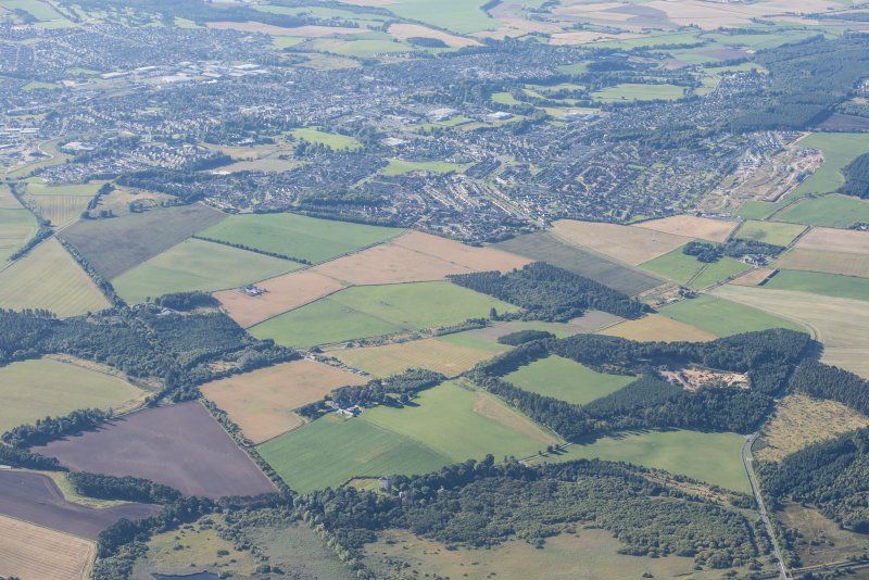 Oblique aerial view of Spynie Palace and Elgin, looking SW.