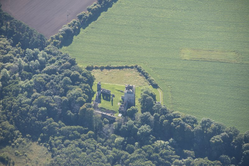 Oblique aerial view of Spynie Palace, looking SE.