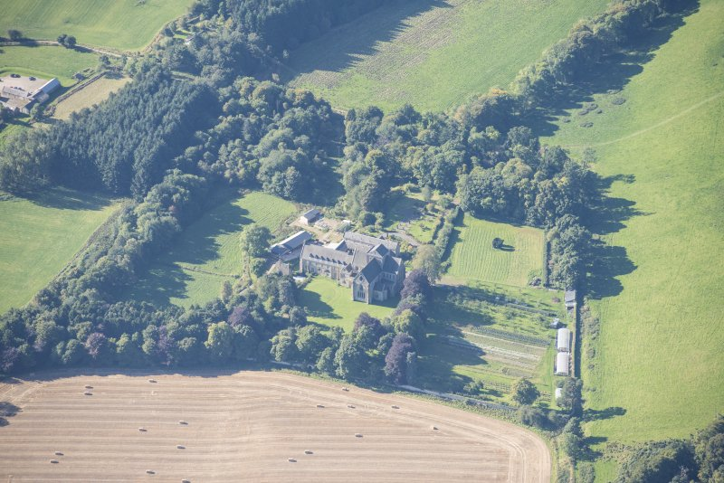 Oblique aerial view of Pluscarden Abbey, looking SSW.