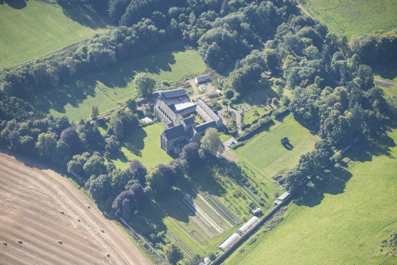 Oblique aerial view of Pluscarden Abbey, looking S.