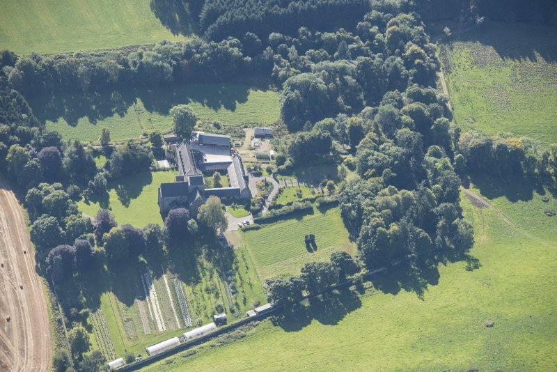 Oblique aerial view of Pluscarden Abbey, looking SSE.