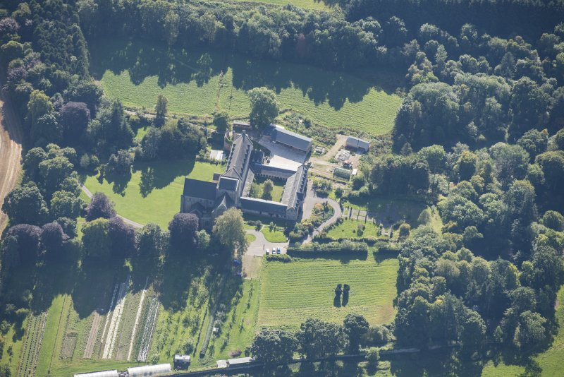 Oblique aerial view of Pluscarden Abbey, looking SE.