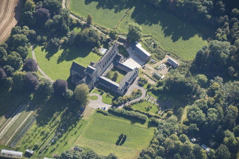 Oblique aerial view of Pluscarden Abbey, looking ESE.