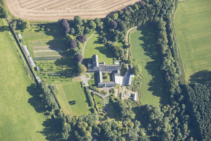 Oblique aerial view of Pluscarden Abbey, looking ENE.
