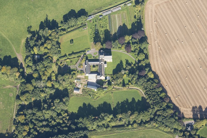 Oblique aerial view of Pluscarden Abbey, looking NNW.