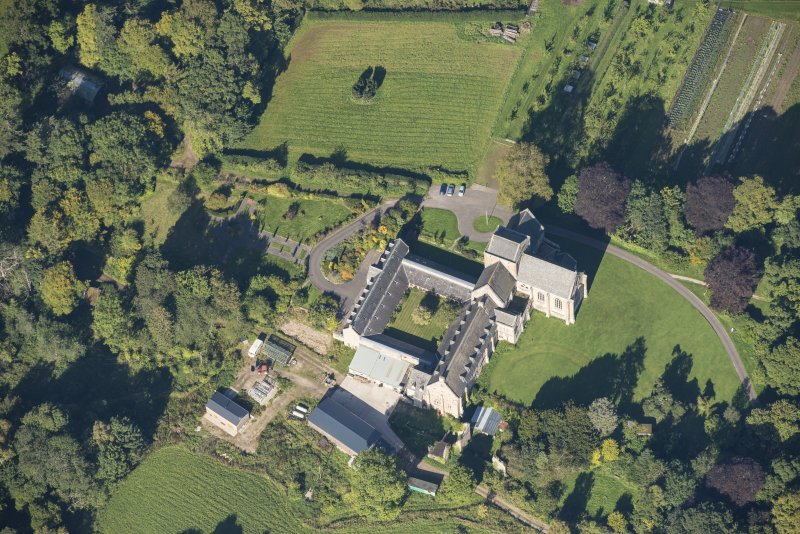 Oblique aerial view of Pluscarden Abbey, looking NW.