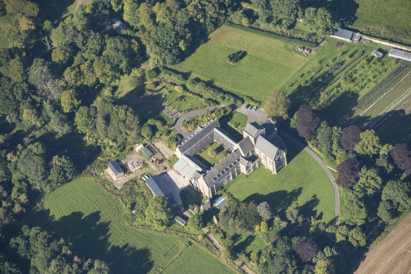 Oblique aerial view of Pluscarden Abbey, looking WNW.
