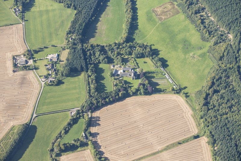 Oblique aerial view of Pluscarden Abbey, looking SW.