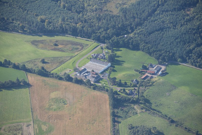 Oblique aerial view of Dallas Dhu Distillery, looking SW.