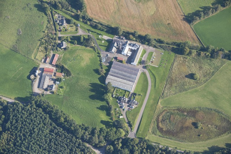 Oblique aerial view of Dallas Dhu Distillery, looking NE.