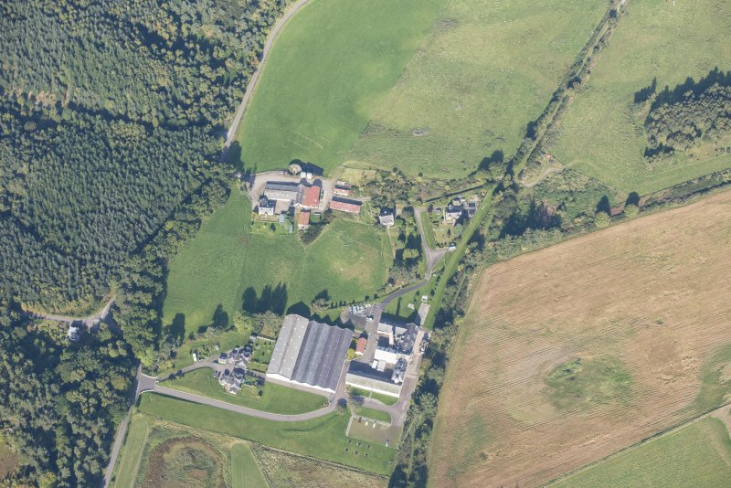 Oblique aerial view of Dallas Dhu Distillery, looking NW.