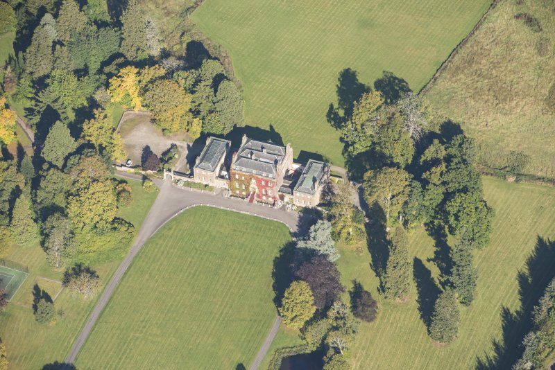 Oblique aerial view of Culloden House, looking N.