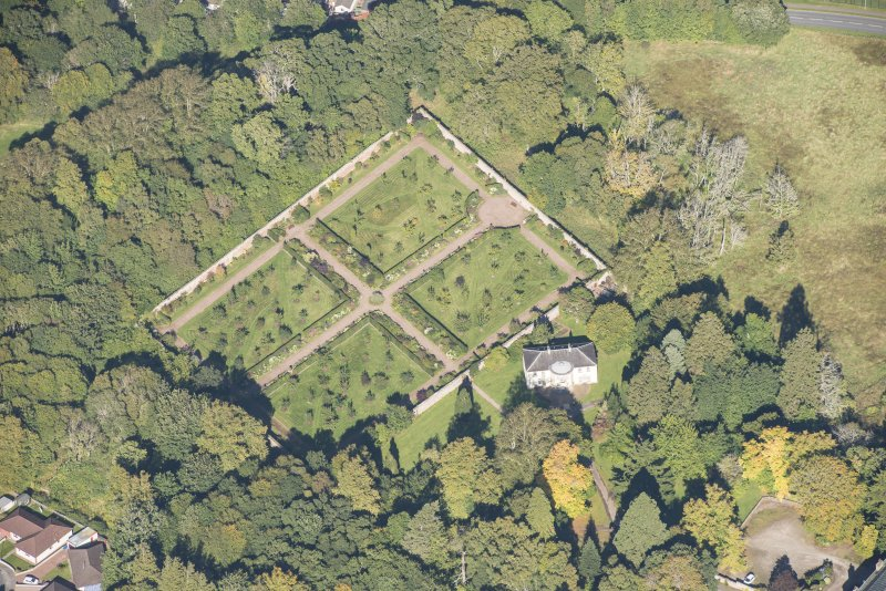 Oblique aerial view of Culloden House Walled Garden and Garden Mansion House, looking N.