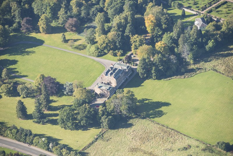 Oblique aerial view of Culloden House, looking W.