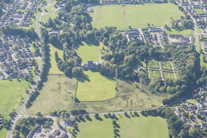 Oblique aerial view of Culloden House and Walled Garden, looking SE.