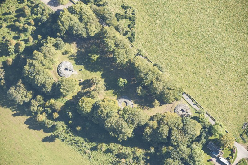 Oblique aerial view of Clava Cairns, looking E.