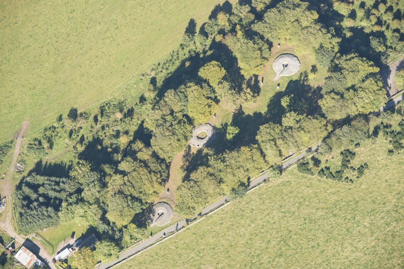 Oblique aerial view of Clava Cairns, looking N.