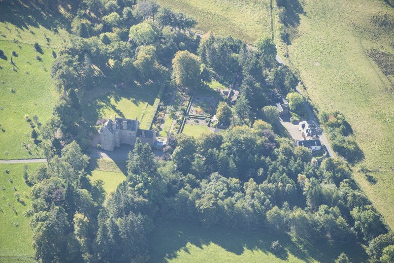 Oblique aerial view of Dalcross Castle, looking SW.