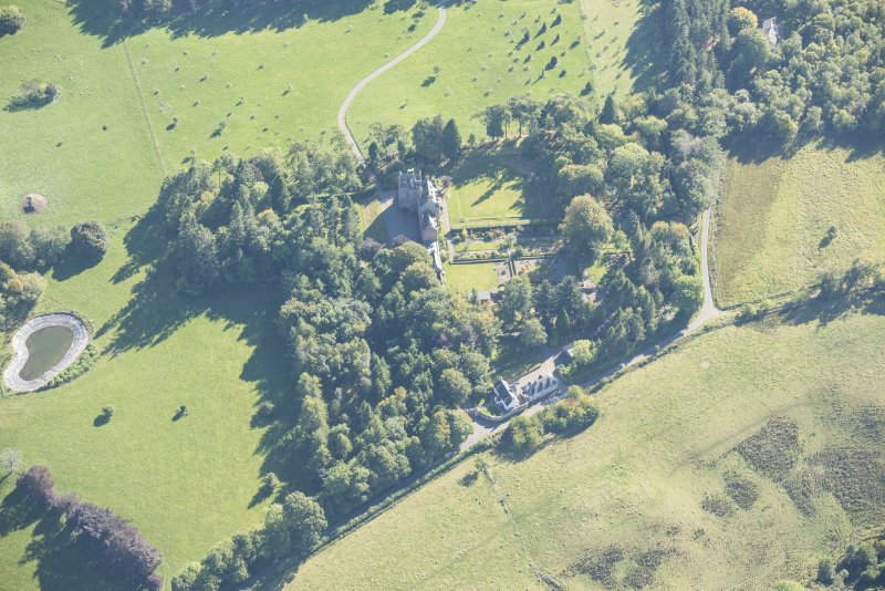Oblique aerial view of Dalcross Castle, looking SSE.