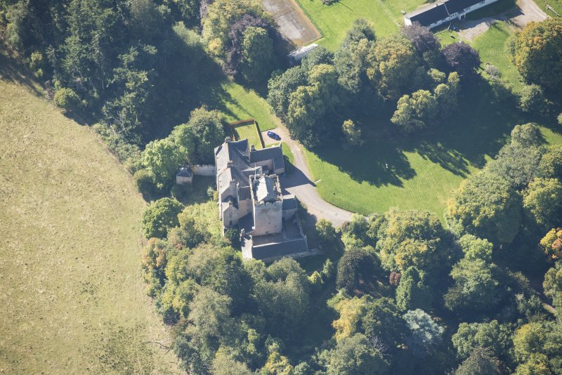 Oblique aerial view of Kilravock Castle and Dovecot, looking SW.