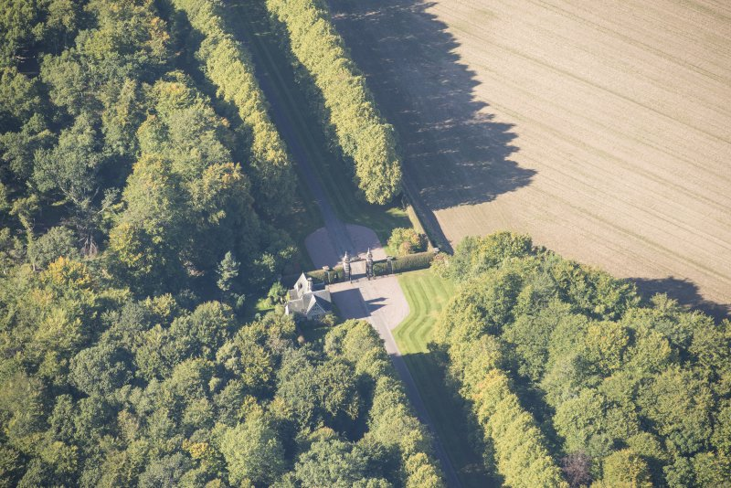 Oblique aerial view of Darnaway Castle West Gate and Lodge, looking NW.