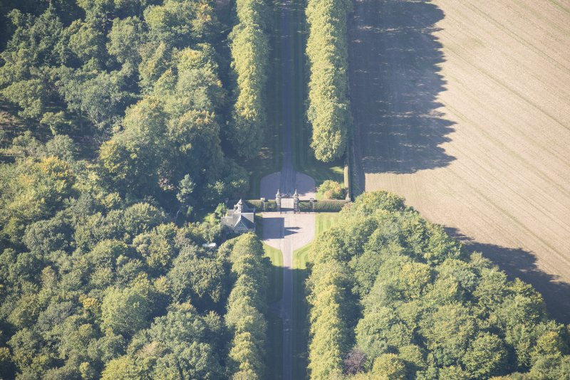 Oblique aerial view of Darnaway Castle West Gate and Lodge, looking WNW.
