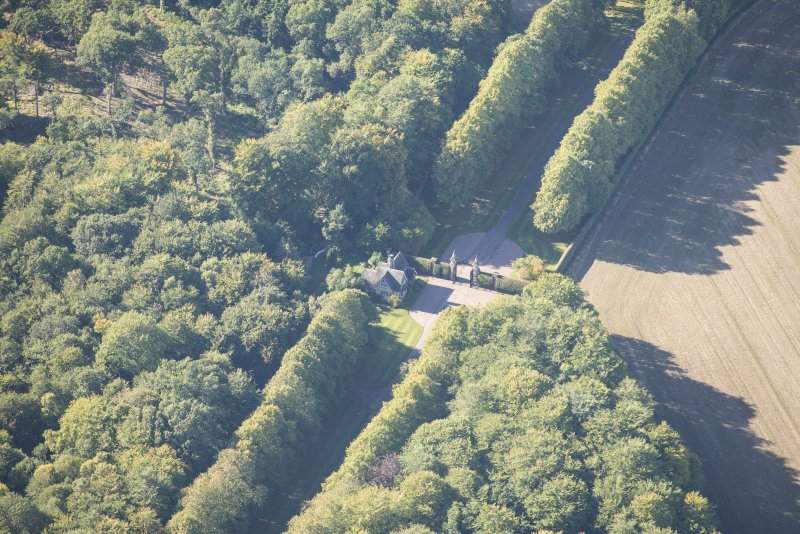 Oblique aerial view of Darnaway Castle West Gate and Lodge, looking W.