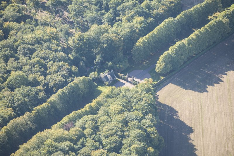 Oblique aerial view of Darnaway Castle West Gate and Lodge, looking SW.