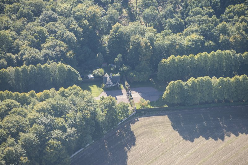 Oblique aerial view of Darnaway Castle West Gate and Lodge, looking S.