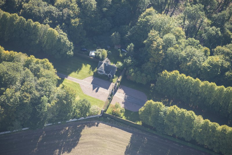 Oblique aerial view of Darnaway Castle West Gate and Lodge, looking SSE.