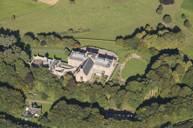 Oblique aerial view of Darnaway Castle, looking N.