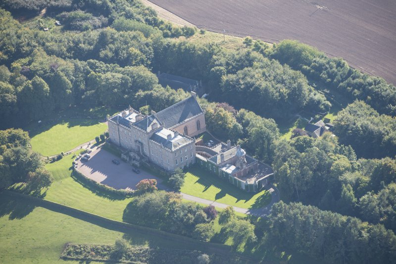 Oblique aerial view of Darnaway Castle, looking SSE.