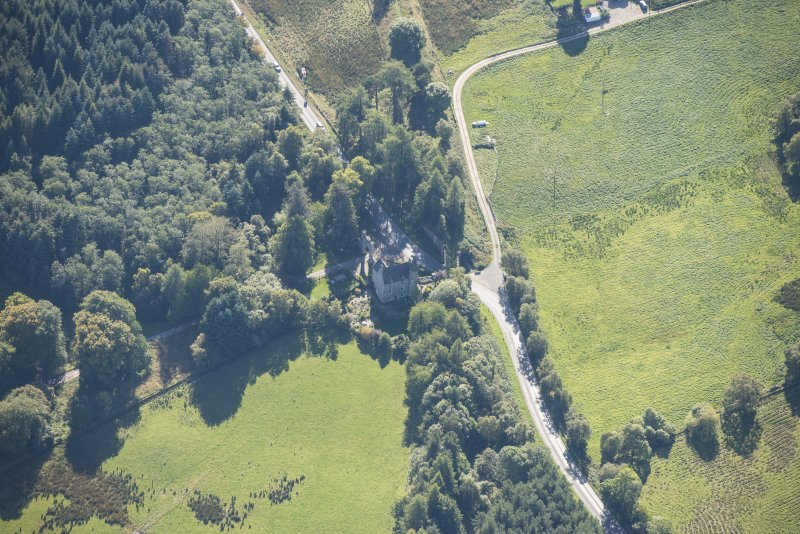 Oblique aerial view of Castle Grant North Lodge, looking SSW.