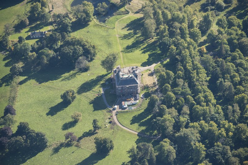 Oblique aerial view of Castle Grant, looking SSE.
