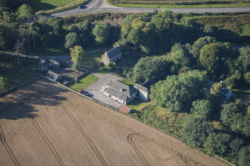 Oblique aerial view of Garlogie Mills Museum of Power and cottages, looking SW.