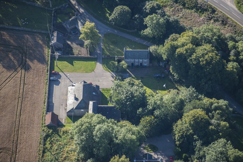 Oblique aerial view of Garlogie Mills Museum of Power and cottages, looking SSE.