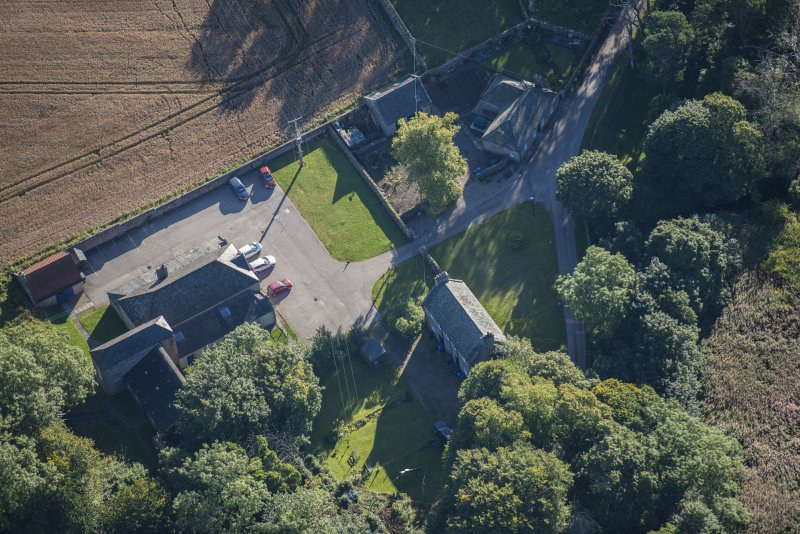 Oblique aerial view of Garlogie Mills Museum of Power and cottages, looking ESE.