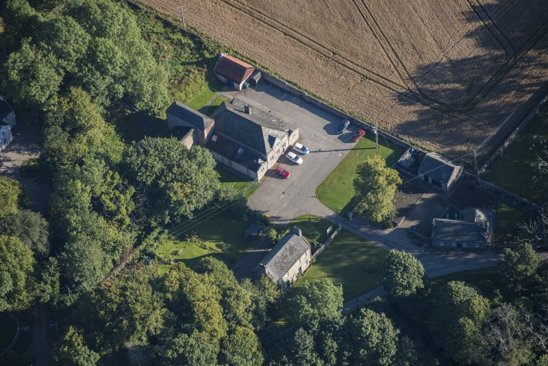 Oblique aerial view of Garlogie Mills Museum of Power and cottages, looking NE.