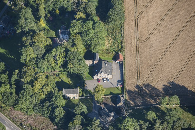 Oblique aerial view of Garlogie Mills Museum of Power and cottages, looking NNW.