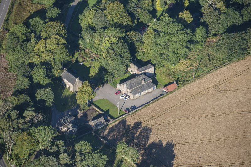 Oblique aerial view of Garlogie Mills Museum of Power and cottages, looking W.