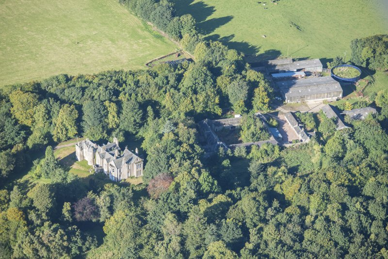 Oblique aerial view of Westhall House and Home Farm, looking W.