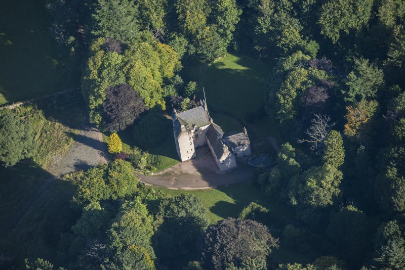Oblique aerial view of Lickleyhead Castle, looking NNE.