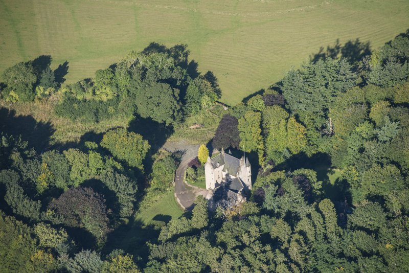 Oblique aerial view of Lickleyhead Castle, looking NNW.