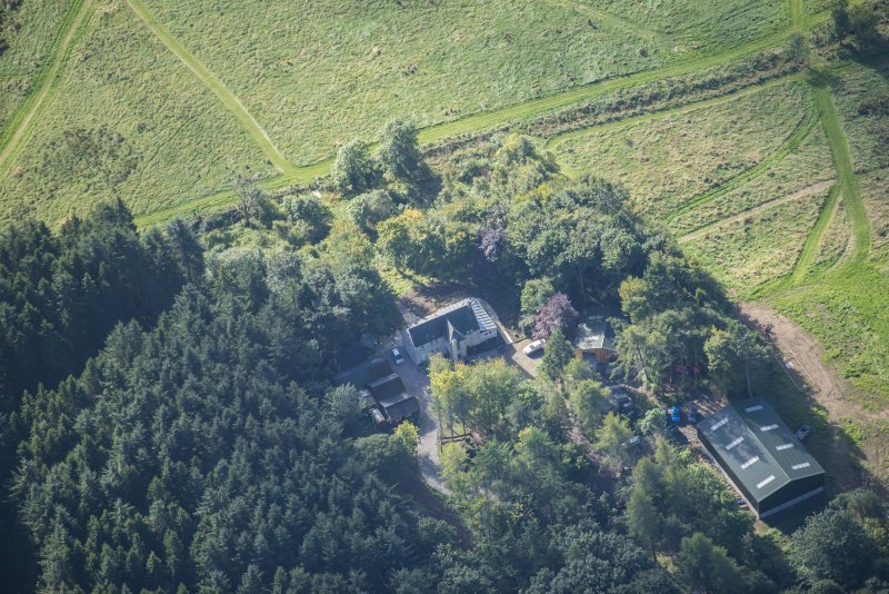 Oblique aerial view of Rothiemay House and Castle, looking S.