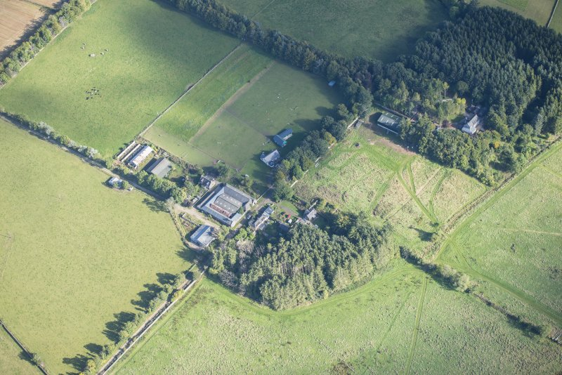 Oblique aerial view of Rothiemay House, Mains of Mayen, Mains of Rothiemay and Rothiemay Castle, looking NE.