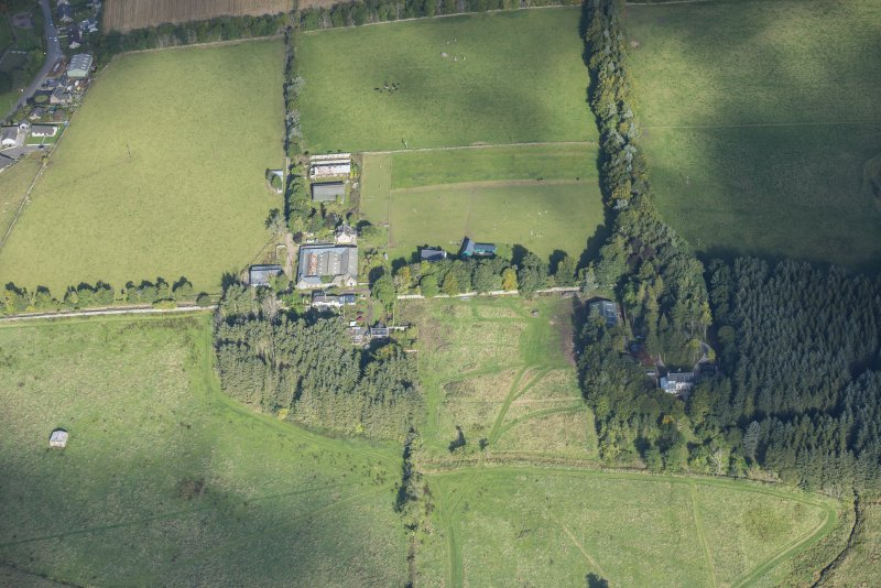 Oblique aerial view of Rothiemay House, Mains of Mayen, Mains of Rothiemay and Rothiemay Castle, looking NW.