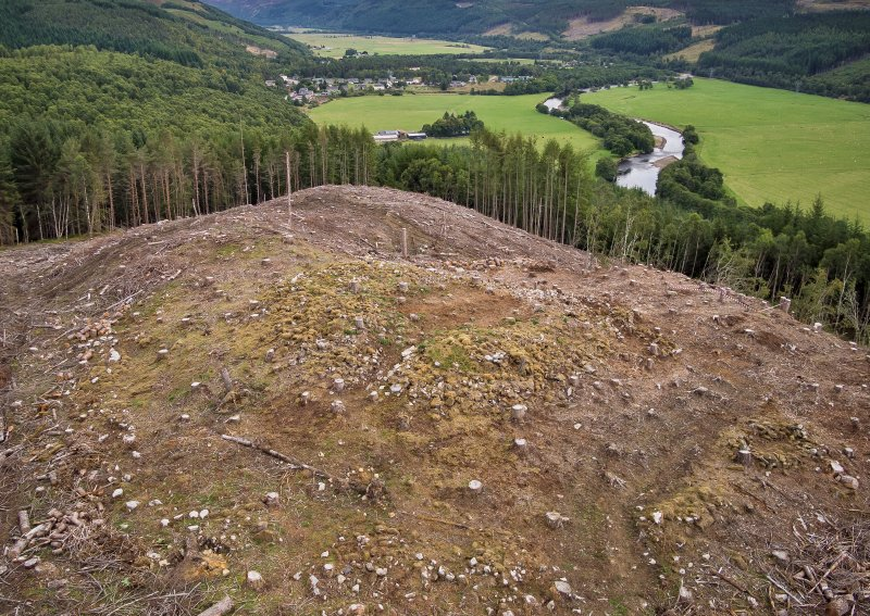 Pre-evaluation aerial photograph by Ed Martin, facing east-north-east over the dun looking down Strath Glass, Comar Wood Dun, Cannich, Strathglass