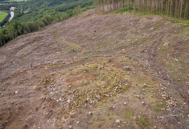 Pre-evaluation aerial photograph by Ed Martin, facing west over the dun, Comar Wood Dun, Cannich, Strathglass