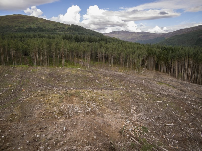 Pre-evaluation aerial photograph by Ed Martin, facing north west over the dun looking over the hills in the distance, Comar Wood Dun, Cannich, Strathglass