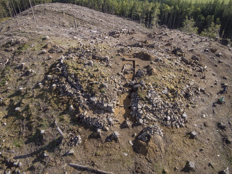 Post-excavation aerial photograph of Trench 1 by Ed Martin, looking east over the dun entrance (Trench 1); image shows the curvilinear outer wall f, Comar Wood Dun, Cannich, Strathglassace alignment